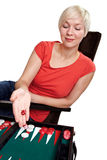 Young woman play backgammon in an armchair Royalty Free Stock Photography