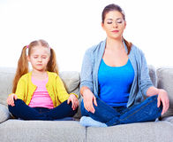 Young woman play with her daughter on sofa Royalty Free Stock Image