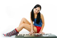Young woman play piano Royalty Free Stock Image