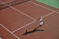Young woman play tennis outdoor Royalty Free Stock Image