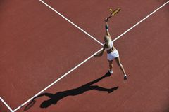 Young woman play tennis outdoor Stock Photo
