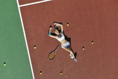 Young woman play tennis outdoor Royalty Free Stock Photos