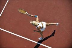 Young woman play tennis outdoor Stock Photos