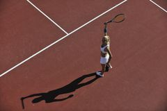 Young woman play tennis outdoor Stock Photography