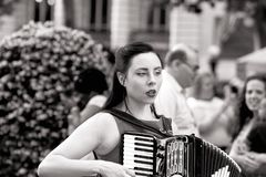 Young Woman Playing An Accordion Black and White Image royalty free stock photo