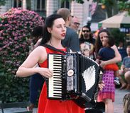 Young Woman Playing an Accordion, New York City stock images
