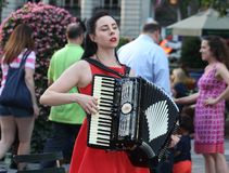 A Young Woman Playing the Accordion Royalty Free Stock Photos