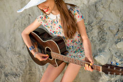 Young woman playing acoustic guitar Stock Photos