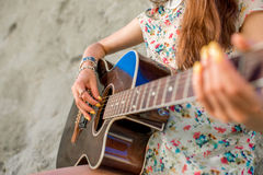 Young woman playing acoustic guitar Royalty Free Stock Photos