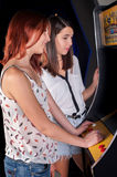 Young woman playing arcade Stock Photos