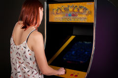 Young woman playing arcade Stock Image