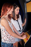 Young woman playing arcade Stock Photography