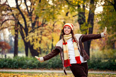 Young woman playing in autumn park royalty free stock images