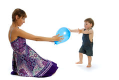 Young woman playing with baby boy royalty free stock photo