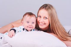 Young woman playing with baby boy Royalty Free Stock Photography