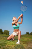 Young woman playing badminton in a city park Royalty Free Stock Images