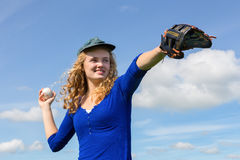 Young woman playing baseball with cap glove and ball Royalty Free Stock Photography