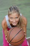 Young woman playing basketball Royalty Free Stock Image