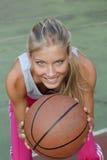 Young woman playing basketball Royalty Free Stock Image