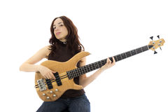 Young woman playing a bass guitar Stock Photo