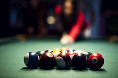 Young woman playing billiard Royalty Free Stock Images