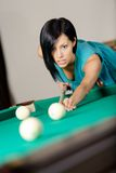 Young woman playing billiard Stock Photo