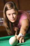 Young Woman Playing Billiards Royalty Free Stock Photos