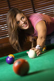Young Woman Playing Billiards Stock Image