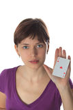 Young woman and playing card Royalty Free Stock Photography