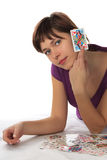 Young woman and playing card. Young woman holds a playing card Jack Royalty Free Stock Image