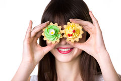 Young woman playing with cream cakes royalty free stock photo