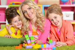 Young woman playing with daughters Royalty Free Stock Photo