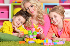 Young woman playing with daughters Royalty Free Stock Images