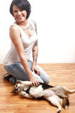Young woman playing with dog Stock Photography