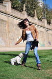 Young woman playing with dog Royalty Free Stock Photography