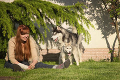 Young woman playing with the dogs. Royalty Free Stock Photos