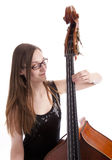 Young woman playing the double bass Royalty Free Stock Image