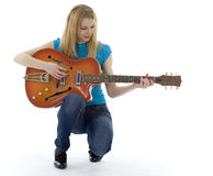 Young woman playing electric guitar Royalty Free Stock Photos
