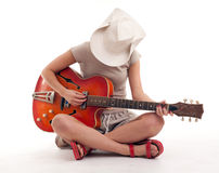 Young woman playing electric guitar Stock Photo
