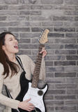 Young Woman Playing a Electric Guitar Royalty Free Stock Photo