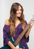Young woman playing an electric guitar Stock Photography