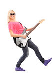 Young woman playing on electric guitar Stock Photos