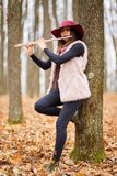 Young woman playing flute outdoor Stock Photo