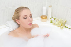 Young woman playing with foam in bath Royalty Free Stock Image