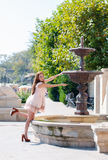 Young woman playing with a fountain Royalty Free Stock Images