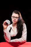 Young woman playing in the gambling. On black background royalty free stock photography