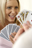 Young woman playing a game of cards, close-up Royalty Free Stock Images
