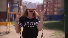 Young woman playing game using VR-helmet for smart phones. Virtual space, augmented reality device. stock footage
