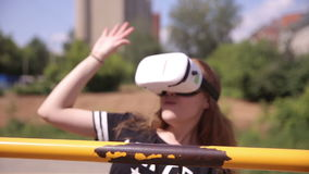 Young woman playing game using VR-helmet for smart phones. Virtual space, augmented reality device. stock video