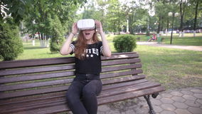 Young woman playing game using VR-helmet for smart phones. Virtual space, augmented reality device. stock video footage
